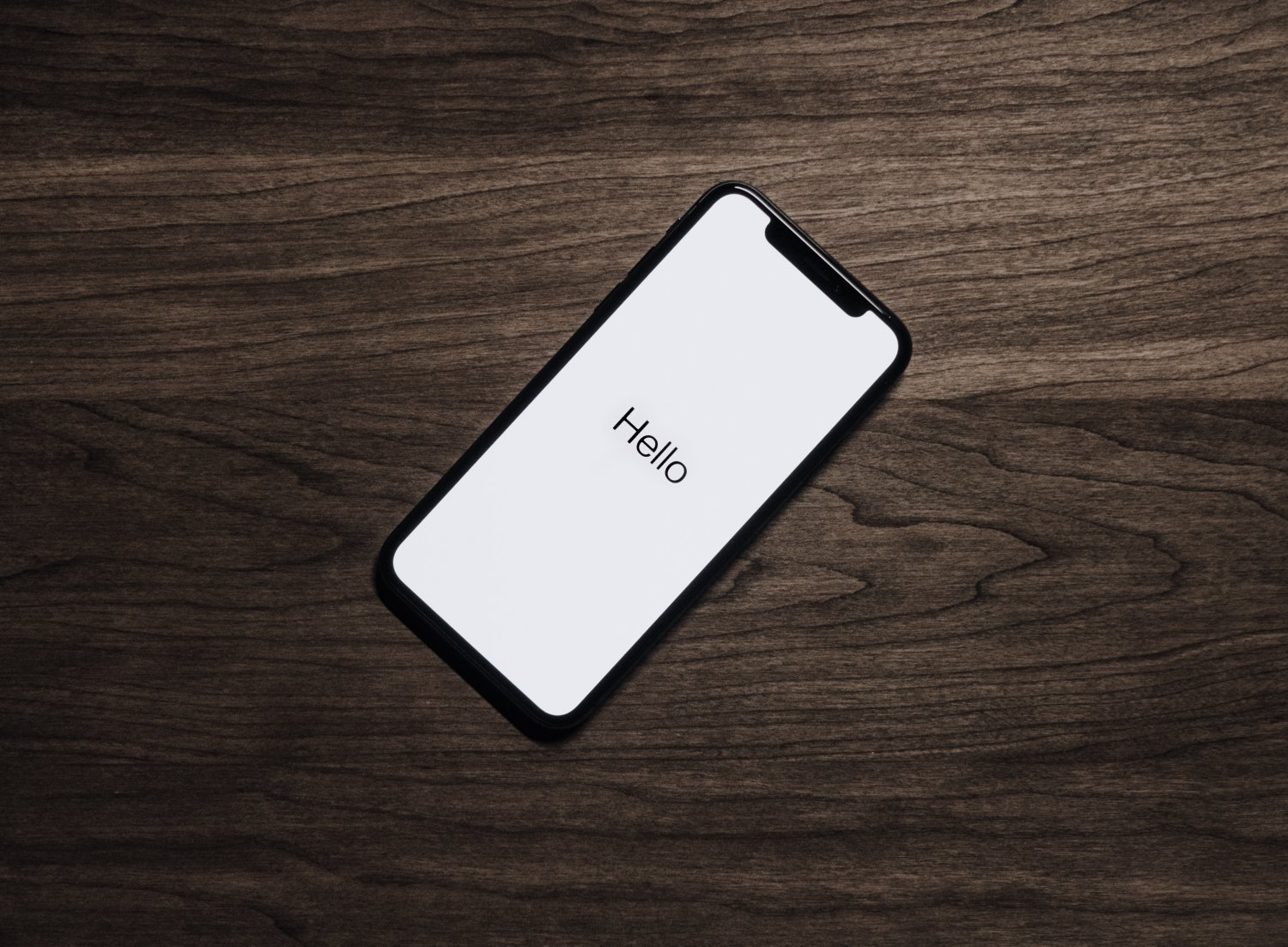 iPhone with hello on screen