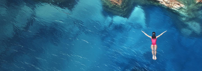 woman diving in to ocean