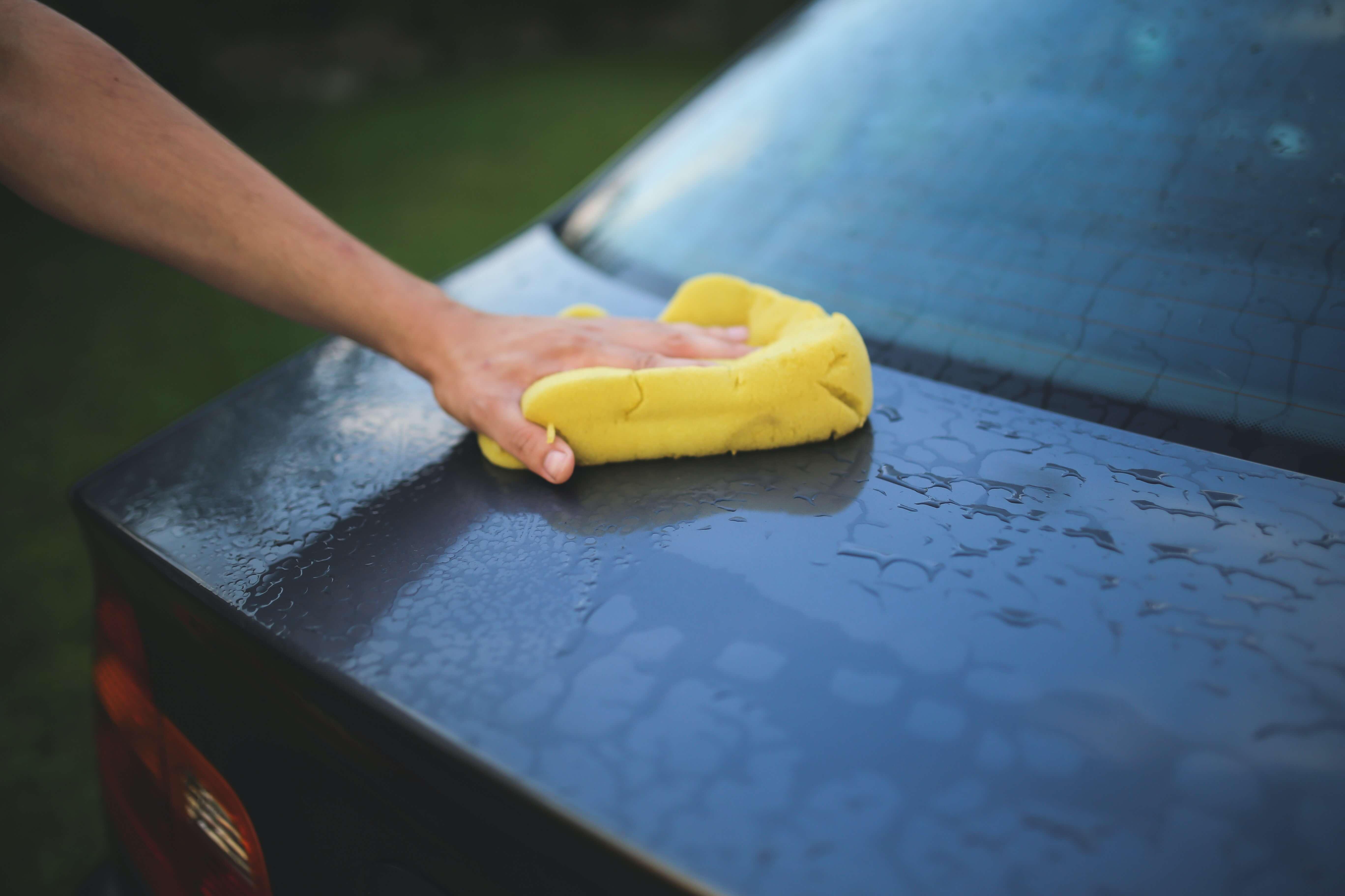 washing-a-car-with-a-sponge